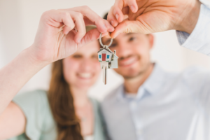 first time modular home buyers holding their key